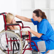 Caring medical worker comforting little patient — Stock Photo