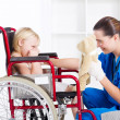 Nurse cheer up sad little girl patient — Stock Photo #11158576