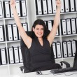 Cheerful businesswoman in office — Stock Photo
