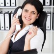 Young businesswoman answering telephone — Stock Photo #11159065