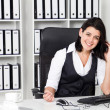 Stock Photo: Happy businesswoman in office