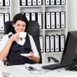 Businesswoman drinking coffee in office — Stock Photo