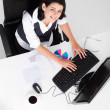 Businesswoman working on computer in office — Stock Photo