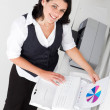 Businesswoman faxing document — Stock Photo