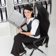 Young businesswoman looking files — Stock Photo