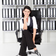 Stock Photo: Businesswoman sitting on office chair