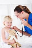 Doctor examining little girl — Stock Photo