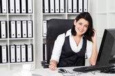 Happy businesswoman in office — Stock Photo