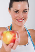 Fitness woman with an apple — Stock Photo