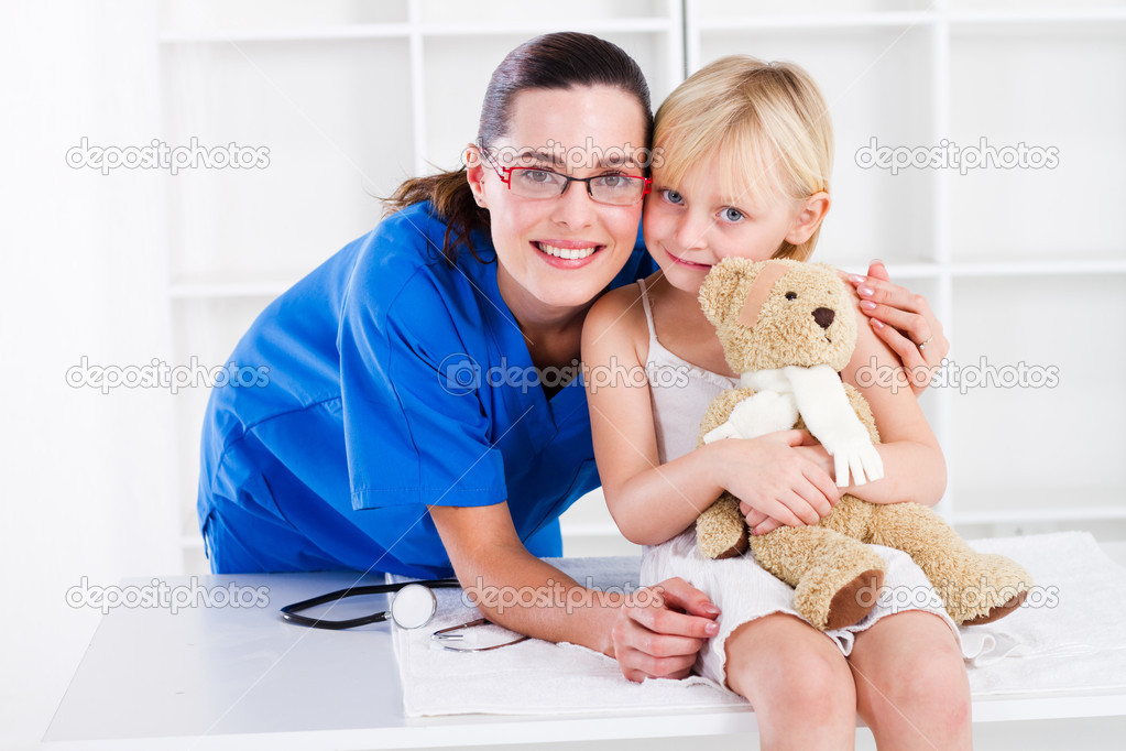 Young pretty nurse and little girl patient  Stock Photo #11158516