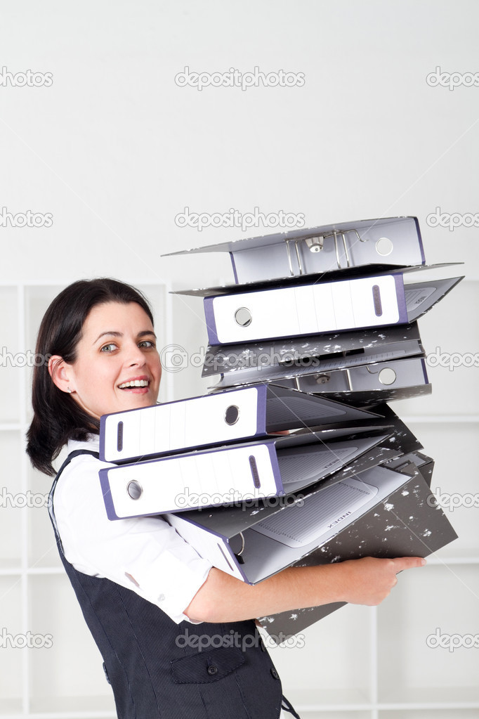 Young businesswoman overloaded with a lot of files — Stock Photo #11159190