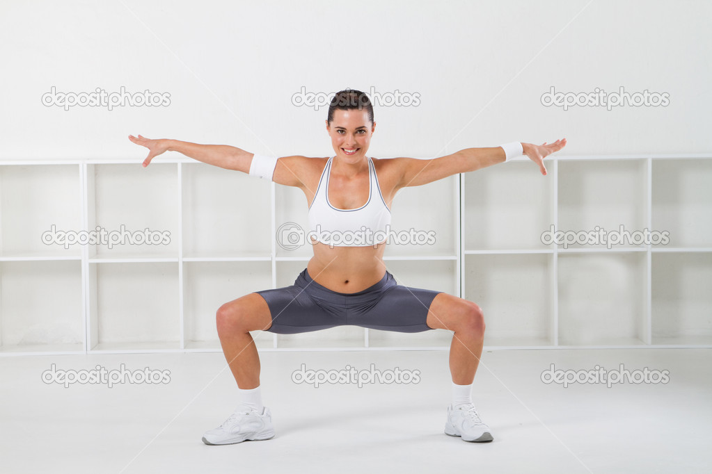 Young beautiful fitness woman stretching, studio shots — Stock Photo #11159386