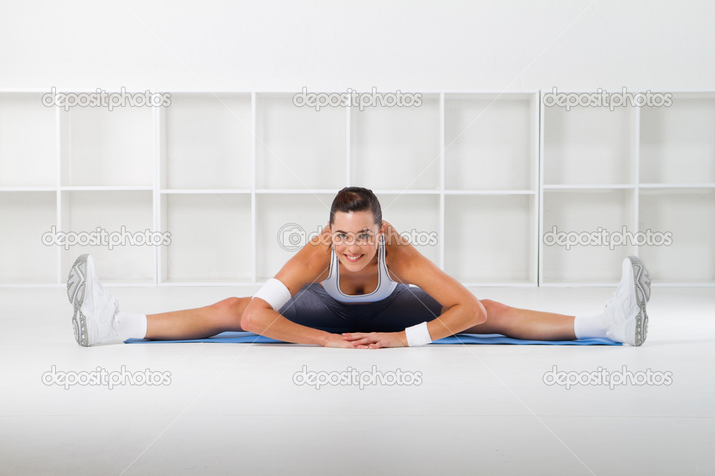 Young beautiful fitness woman stretching, studio shots  Stock Photo #11159426