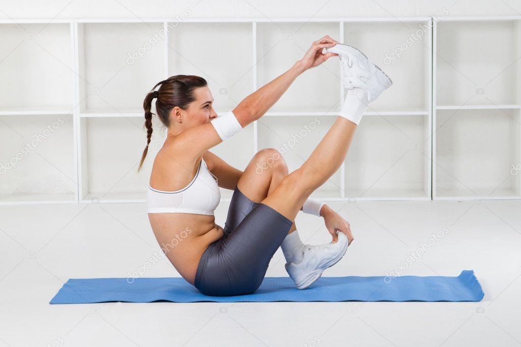 Young beautiful fitness woman stretching, studio shots — Stock Photo #11159434