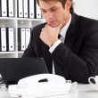 Thoughtful businessman at work — Stock Photo #11280408