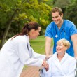 Friendly doctor greeting recovering senior patient — Stock Photo