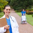 Friendly female doctor portrait outdoors — Stock Photo #11281113