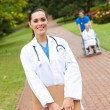 Beautiful female doctor portrait outdoors — Stock Photo
