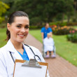 Friendly female doctor portrait outdoors — Stock Photo