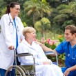 Male doctor talking to senior patient — Stock Photo #11281145