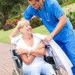 Caring doctor giving his jacket to a senior patient — Stock Photo #11281152
