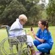 Female nurse explain how to take the medication to senior patient — Stock Photo