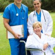 Group portrait of doctor, nurse and senior patient — Stock Photo