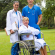 Group portrait of doctor, nurse and senior patient in hospital garden — Stock Photo #11281198