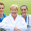 Stock Photo: Senior patient together with doctor and nurse outdoors
