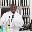 African american medical scientist with microscope in laboratory — Stock Photo