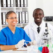 African american lab technicians working in lab — Stock Photo #11281457