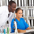African american scientists working in lab - Stock Photo