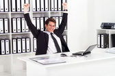 Cheerful young businessman in office — Stock Photo