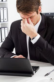 Stressful businessman at work — Stock Photo