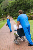 Medical worker saying good bye to patient — Stock Photo