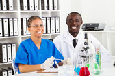 African american lab technicians working in lab — Stock Photo
