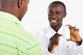 African american pharmacist and customer — Stock Photo