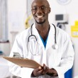 Stock Photo: Male african doctor