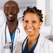Happy african doctor and nurse — Stock Photo