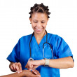 African doctor checking patient's pulse — Stock Photo #11306803