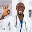 Happy african doctor giving OK hand sign — Stock Photo #11306808