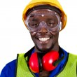 Foto de Stock  : Happy african industrial worker closeup