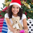 Cute little girl with presents — Stock Photo