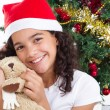 Happy cute little girl with presents — Stock Photo