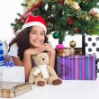Cute little girl with presents near a christmas tree — Foto Stock