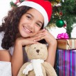 Stock Photo: Happy cute little girl with presents