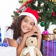 Cute little girl with christmas presents — ストック写真