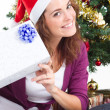 Royalty-Free Stock Photo: Happy young woman under a Christmas tree