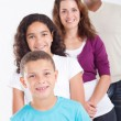 Happy multiracial family of four studio portrait — Stockfoto