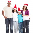 Stock Photo: Happy multiracial family of four wearing santa hats
